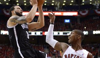 Brooklyn Nets' Deron Williams, left, drives to the net against Toronto Raptors' Terrence Ross during the second half of Game 7 of the opening-round NBA basketball playoff series in Toronto, Sunday, May 4, 2014. (AP Photo/The Canadian Press, Frank Gunn)