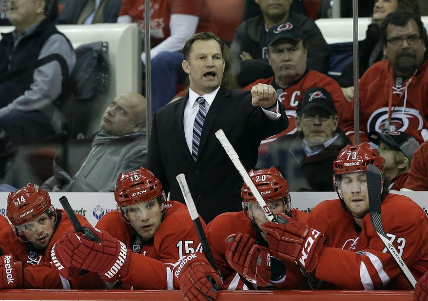 FILE - In this Jan. 31, 2014 file photo, Carolina Hurricanes coach Kirk Muller directs his team during the first period of an NHL hockey game against the St. Louis Blues in Raleigh, N.C. The Hurricanes have fired Muller. The team announced his dismissal Monday, May 5, 2014. (AP Photo/Gerry Broome, File)
