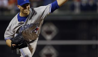 Toronto Blue Jays' J.A. Happ piches during the third inning of an interleague baseball game against the Philadelphia Phillies, Monday, May 5, 2014, in Philadelphia. (AP Photo/Matt Slocum)