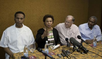 Congresswoman Barbara Lee, speaks during a press conference, accompanied by Congressman Emanuel Cleaver, left, Congressman Sam Farr, second from right, and Congressman Gregory Meeks at the Hotel Saratoga in Havana, Cuba, Monday, May 5, 2014. Congresswoman Lee spoke about the situation of imprisoned U.S. government subcontractor Alan Gross. (AP Photo/Franklin Reyes)