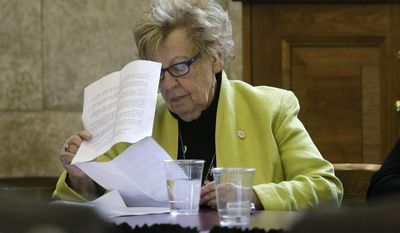 New Jersey Sen. Loretta Weinberg, D-Teaneck, N.J., reads over legislation before speaking at a hearing in Trenton, N.J., Monday, May 5, 2014. Lawmakers were holding a hearing on Weinberg's bill that would reduce the legal capacity of ammunition magazines from 15 to 10. The state Senate's Law and Public Safety Committee advanced the bill Monday by a 3-2 vote. Several opponents of the bill told lawmakers it would be a mistake and would improperly restrict their freedom. (AP Photo/Mel Evans)