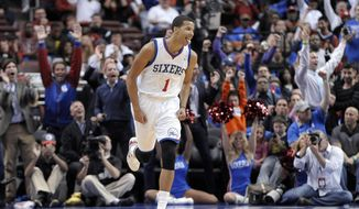 FILE - In this Oct. 30, 2013 file photo, Philadelphia 76ers' Michael Carter-Williams (1) celebrates after making a 3-point basket during the first half of an NBA basketball game against the Miami Heat, in Philadelphia. Carter-Williams has won the NBA's Rookie of the Year Award. The league said Monday, May 5, 2014,  that he received 104 of a possible 124 first-place votes.(AP Photo/Michael Perez, File)