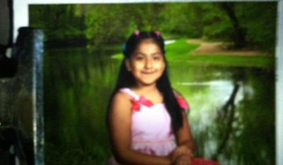 This photo provided by the Oklahoma Department of Public Safety, shows Montserrat Aguirre. An Amber Alert  has been issued for the 8-year-old Aguirre, of Tulsa, who was apparently snatched by a motorist from outside an apartment. Aguirre was playing on a swing set at about 7:20 p.m. Sunday, May 4, 2014, when a small white car pulled up and a white man got out, grabbed her and put her in the car before driving away. (AP Photo/Oklahoma Department of Public Safety)