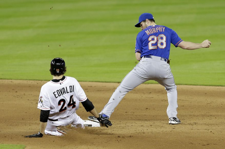 New York Mets second baseman Daniel Murphy (28) forces out Miami Marlins' Nate Eovaldi (24) on a fielder's choice during the fifth inning of a baseball game in Miami, Monday, May 5, 2014. (AP Photo/Alan Diaz)