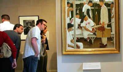 """FILE - In this April 26, 2005 file photo, Norman Rockwell's """"The Rookie"""" is displayed, at right, during an exhibit of """"Rockwell and the Red Sox"""" at the Museum of Fine Arts in Boston. """"The Rookie (Red Sox Locker Room),"""" appeared on the cover of the March 2, 1957, issue of the Saturday Evening Post. Christie's is offering it May 22, 2014, with a pre-sale estimate of $20 million to $30 million, which the auction house says represents that highest auction estimate ever for Rockwell. (AP Photo/Chitose Suzuki, File)"""