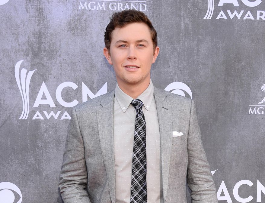 FILE - This April 6, 2014 file photo shows singer Scotty McCreery at the 49th annual Academy of Country Music Awards in Las Vegas. Police say McCreery was the victim of an early morning home invasion near the campus of North Carolina State University, where he is a student. Raleigh Police spokesman Jim Sughrue says officers were called shortly before 2 a.m. Monday, May 5, to an apartment about a mile from campus. Three suspects armed with guns are reported to have taken wallets, cash and electronic items. (Photo by Al Powers/Powers Imagery/Invision/AP, File)