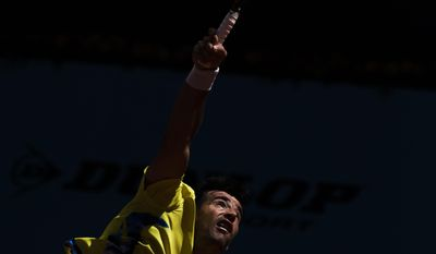 Ivan Dodig from Croatia serves during a Madrid Open tennis tournament match against Kei Nishikori from Japan, in Madrid, Spain, Monday, May 5, 2014. (AP Photo/Andres Kudacki)