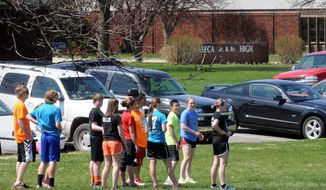 Students at the Waseca Junior and Senior High School in Waseca, Minn., participate in outdoor activities, Monday, May 5, 2014. A 17-year-old classmate was arrested last week, charged with plotting an attack on the school in south-central Minnesota. (AP Photo/The Mankato Free Press, John Cross)