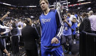 Dallas Mavericks' Dirk Nowitzki (41), of Germany,  walks off the court after the team's loss to San Antonio Spurs in Game 7 of the opening-round NBA basketball playoff series, Sunday, May 4, 2014, in San Antonio. San Antonio won 119-96. (AP Photo/Eric Gay)