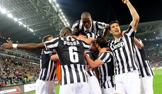 Juventus players celebrate after their teammate Simone Padoin, at center, scored during a Serie A soccer match between Juventus and Atalanta at the Juventus stadium, in Turin, Italy, Monday, May 6, 2014. (AP Photo/Massimo Pinca)