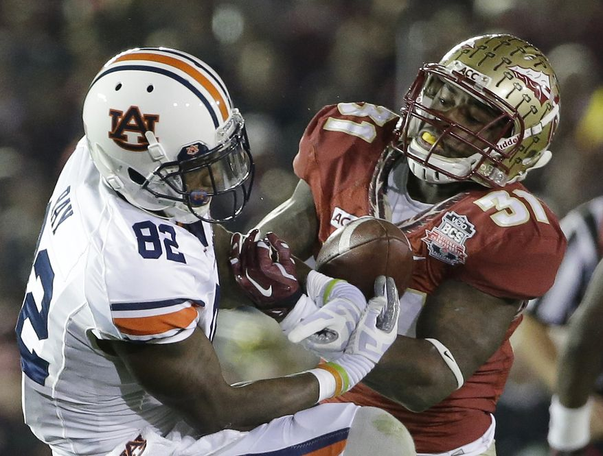 Florida State's Terrence Brooks breaks up a pass intended for Auburn's Melvin Ray during the second half of the NCAA BCS National Championship college football game Monday, Jan. 6, 2014, in Pasadena, Calif. (AP Photo/David J. Phillip)