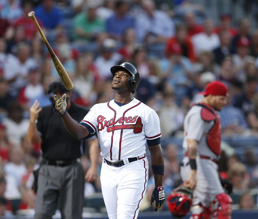 Atlanta Braves left fielder Justin Upton (8) flips his bat as he walks back to the dugout after striking out in the third inning of a baseball game against the St. Louis Cardinals Monday, May 5, 2014 in Atlanta.  (AP Photo/John Bazemore)