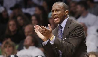 Toronto Raptors' Dwane Casey reacts during the first half of Game 6 of the opening-round NBA basketball playoff series against the Brooklyn Nets, Friday, May 2, 2014, in New York. (AP Photo/Frank Franklin II)