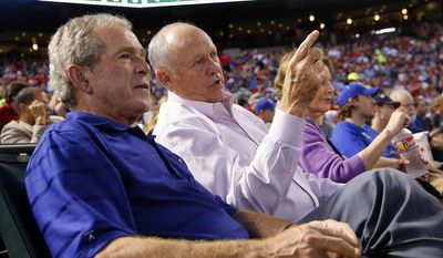 Former Texas Rangers president Nolan Ryan, right, shared the front row with former President George W. Bush as Ryan made his return, with his new team the Houston Astros, at the Globe Life Park in Arlington, TX on Friday, April 11, 2014.(AP Photo/The Dallas Morning News, Tom Fox)