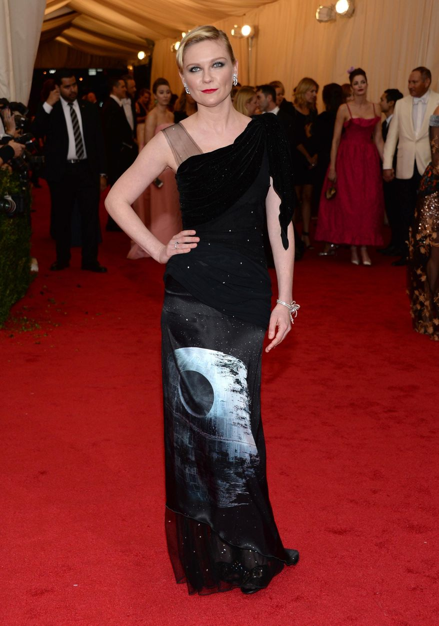 """Kirsten Dunst attends The Metropolitan Museum of Art's Costume Institute benefit gala celebrating """"Charles James: Beyond Fashion"""" on Monday, May 5, 2014, in New York. (Photo by Evan Agostini/Invision/AP)"""