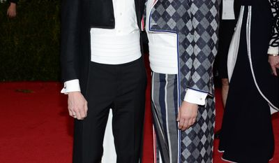 """Neil Patrick Harris, left, and David Burtka attend The Metropolitan Museum of Art's Costume Institute benefit gala celebrating """"Charles James: Beyond Fashion"""" on Monday, May 5, 2014, in New York. (Photo by Evan Agostini/Invision/AP)"""