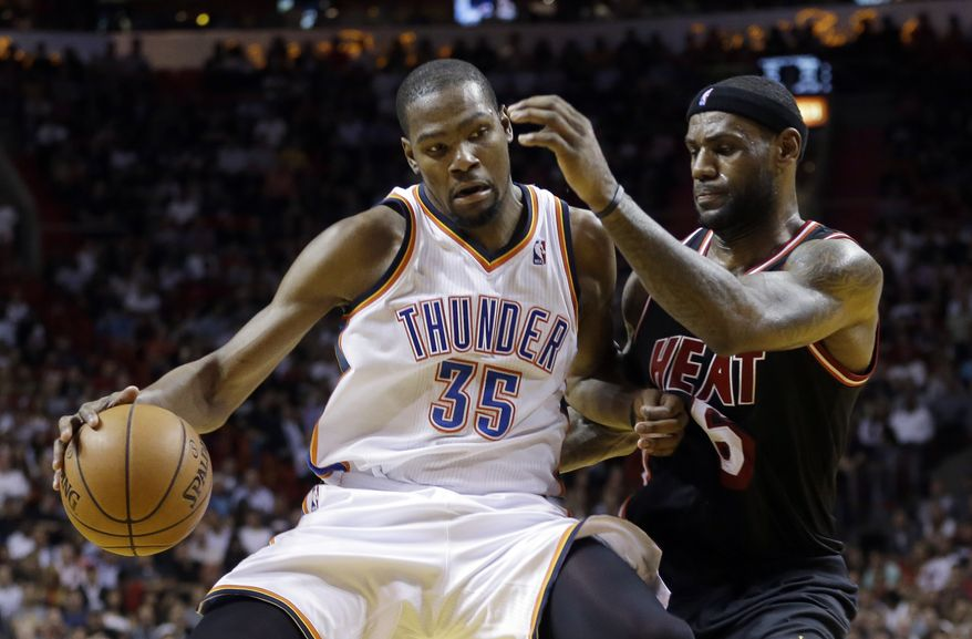 FILE - In this Jan. 29, 2014 file photo, Miami Heat small forward LeBron James (6) puts pressure on Oklahoma City Thunder small forward Kevin Durant (35) during the fourth period of an NBA basketball game in Miami. James says Durant would be a deserving winner of the NBA MVP award. It's expected that Durant will be announced as this season's MVP later this week. (AP PhotoAlan Diaz, File)