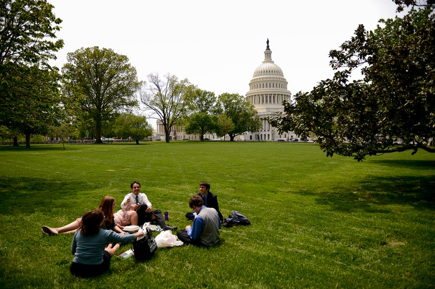 Capitol Hill office workers take their lunch break on the grounds of the U.S. Capitol Building on a pleasant spring day, Washington, D.C., Monday, May 5, 2014. (Andrew Harnik/The Washington Times)