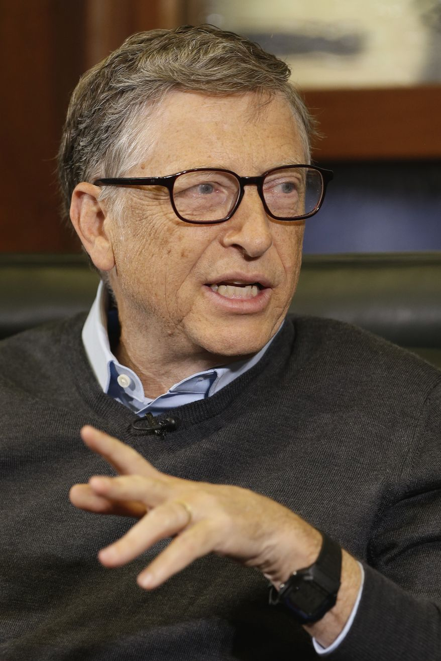 Microsoft co-founder and Berkshire Hathaway board member Bill Gates gestures during an interview with Liz Claman on the Fox Business Network in Omaha, Neb., Monday, May 5, 2014. The annual Berkshire Hathaway shareholders meeting concluded over the weekend. (AP Photo/Nati Harnik)