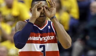 Washington Wizards guard Bradley Beal celebrates a three-point bucket against the Indiana Pacers during the second half of game 1 of the Eastern Conference semifinal NBA basketball playoff series in Indianapolis, Monday, May 5, 2014. The wizards defeated the Pacers 102-96. (AP Photo/Michael Conroy)