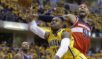 Washington Wizards forward Drew Gooden (90) fouls Indiana Pacers guard C.J. Watson as he shoots during the second half of game 1 of the Eastern Conference semifinal NBA basketball playoff series in Indianapolis, Monday, May 5, 2014. The wizards defeated the Pacers 102-96. (AP Photo/Michael Conroy)