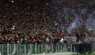 Police officials and representatives of the Napoli club talk with Napoli supporters prior to the start of the Italian Cup final soccer match between Fiorentina and Napoli Rome's Olympic stadium, Saturday, May 3, 2014. At least one fan and one police officer were reportedly shot before the Italian Cup final between Napoli and Fiorentina, and the fan was in serious condition. As a result, the start of the final was delayed, and there were scenes of violence inside the stadium with a firefighter injured by fireworks thrown from the stands. The shootings occurred in an area where Napoli fans were gathering for the match, the ANSA news agency reported. (AP Photo/Alessandra Tarantino)