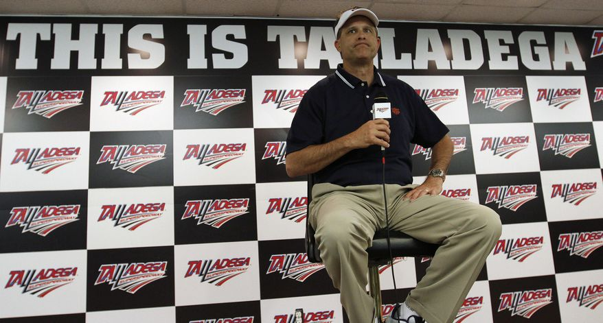 Auburn Head Football Coach Gus Malzahn speaks during a news conference before the NASCAR Aaron's 499 Sprint Cup series auto race at Talladega Superspeedway, Sunday, May 4, 2014, in Talladega, Ala. (AP Photo/Butch Dill)
