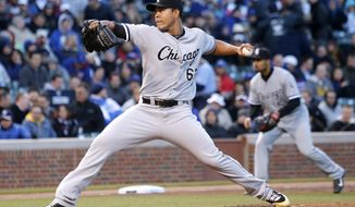 Chicago White Sox starting pitcher Jose Quintana delivers during the first inning of an interleague baseball game against the Chicago Cubs Monday, May 5, 2014, in Chicago. (AP Photo/Charles Rex Arbogast)