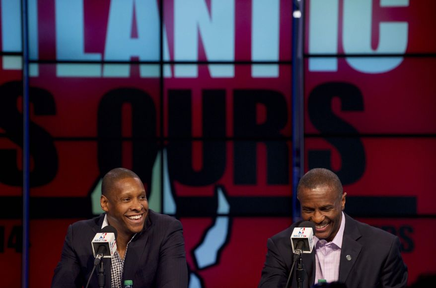 Toronto Raptors president and general manager Masai Ujiri, left, and head coach Dwane Casey address the media during an NBA basketball news conference, Tuesday, May 6, 2014. Casey has agreed to a three-year contract extension after Toronto won a franchise-record 48 games this season. (AP Photo/The Canadian Press, Galit Rodan)