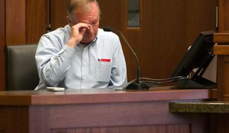 In this March 27, 2014, file photo, Lorin Holm, an exiled member of the Fundamentalist Church of Jesus Christ of Latter Day Saints, wipes away a tear as he describes his hopes for the future of his family during a custody hearing between Holm and his two ex-wives who still belong to the FLDS Church in 5th District Court in St. George, Utah. Several men exiled from Warren Jeffs' polygamous sect are warning a judge that requiring a man to pay his ex-wives' attorney fees after winning a recent custody suit would have a chilling effect on others who have been kicked out and want their children back.  (AP Photo/The Spectrum & Daily News,  Jud Burkett, Pool, File)