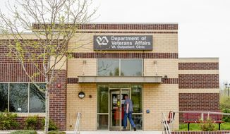 A man visits the Department of Veterans Affairs Outpatient Clinic in Fort Collins, Colo., Monday, May 5, 2014. Employees at the clinic were instructed to falsify records to make it appear that patients were getting appointments close to the day requested, government investigators said.  (AP Photo/The Coloradoan, Erin Hull)