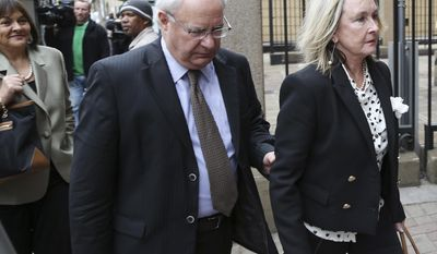 June Steenkamp, mother of Reeva Steenkamp, right, accompanied by an unidentified man, arrives at the high court in Pretoria, South Africa, Tuesday, May 6, 2014. Using witness accounts of a panicked nighttime phone call from Oscar Pistorius begging for help and his desperate pleas for Reeva Steenkamp to stay alive, the defense at his murder trial tried to reinforce its case Monday that the double-amputee Olympian fatally shot his girlfriend in a tragic error of judgment. (AP Photo/Themba Hadebe)
