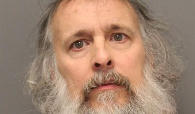 This police booking photo provided by the Loudoun County Sheriff's Office shows Charles Severance, 53.  Authorities say Severance,  wanted in Virginia for questioning in three unsolved slayings in the past decade, has been extradited from West Virginia on an unrelated weapons charge to Loudoun County, Va.  (AP Photo/Loudoun County Sheriff)