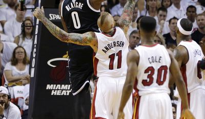 Brooklyn Nets' Andray Blatche (0) shoots as Miami Heat's Chris Anderson (11) defends in the first half of Game 1 in an NBA Eastern Conference semifinal basketball series, Tuesday, May 6, 2014, in Miami. (AP Photo/Lynne Sladky)