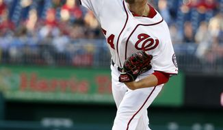 CORRECTS TO STARTER, NOT RELIEF - Washington Nationals starter pitcher Blake Treinen throws during the first inning of a baseball game against the Los Angeles Dodgers at Nationals Park, Tuesday, May 6, 2014, in Washington. He was promoted from Triple-A Syracuse to start the game. (AP Photo/Alex Brandon)
