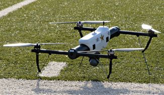** FILE ** In this May 14, 2013, file photo, one of several small drones designed for use by law enforcement and first responders is shown at University of North Dakota in Grand Forks, N.D. (AP Photo/Minnesota Public Radio, Dan Gunderson, File)