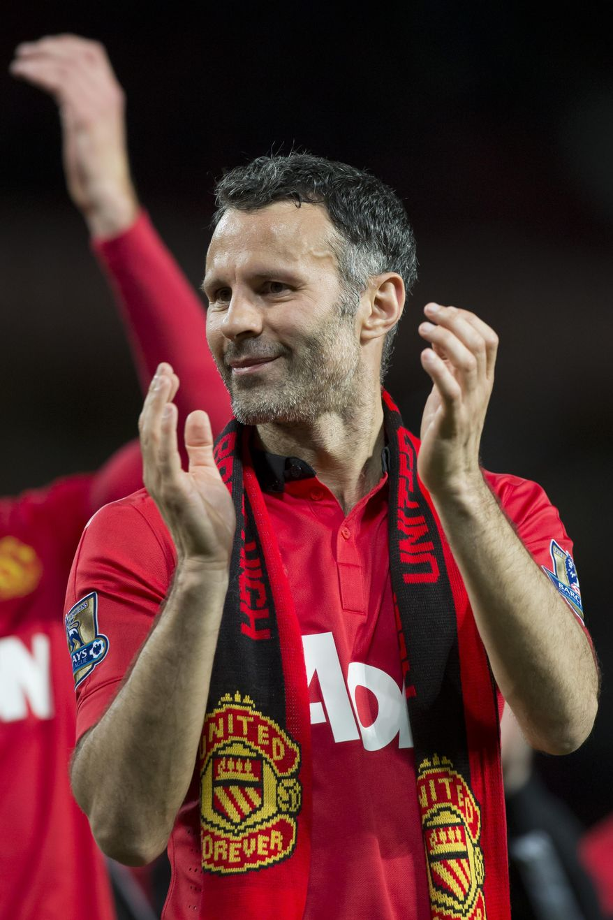 Manchester United's interim manager Ryan Giggs applauds supporters after his team's English Premier League soccer match against Hull City,  at Old Trafford Stadium, Manchester, England, Tuesday May 6, 2014. (AP Photo/Jon Super)