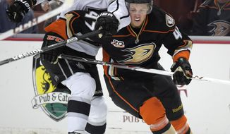 Los Angeles Kings center Jarret Stoll, left, and Anaheim Ducks defenseman Hampus Lindholm, of Sweden, battle for the puck during the first period in Game 2 of an NHL hockey second-round Stanley Cup playoff series, Monday, May 5, 2014, in Anaheim, Calif.  (AP Photo/Mark J. Terrill)