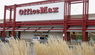 FILE - This Nov. 1, 2013 file photo shows the exterior of an Office Max store in Chicago. Office Depot is planning to close at least 400 U.S. stores, as its merger with OfficeMax resulted in an overlap of retail locations that can be consolidated. The office supply retailer had 1,900 stores in the U.S. at the end of the first quarter, so the plans call for closing about 21 percent of them. Office Depot and OfficeMax Inc. completed their $1.2 billion deal last November. (AP Photo/Charles Rex Arbogast, File)