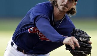 Cleveland Indians starting pitcher Josh Tomlin delivers against the Minnesota Twins in the first inning of a baseball game, Tuesday, May 6, 2014, in Cleveland. (AP Photo/Mark Duncan)