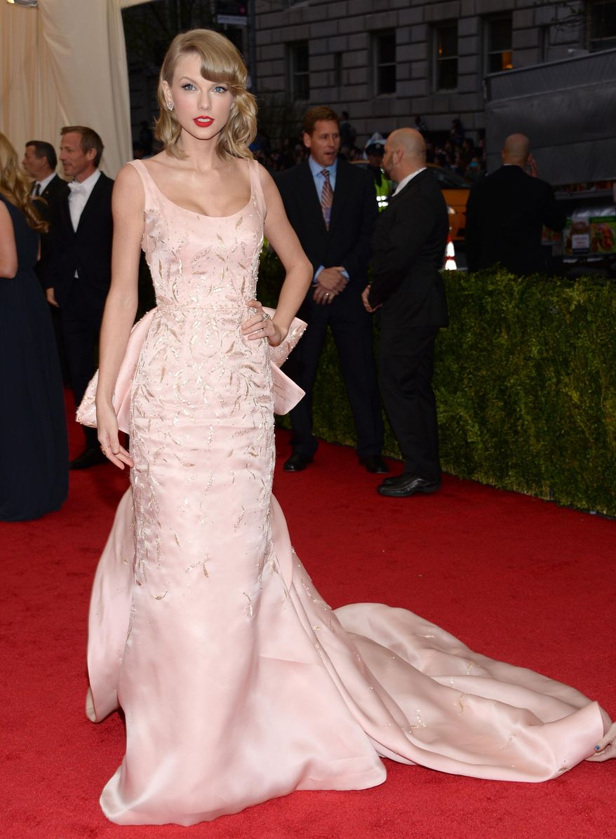 """Taylor Swift attends The Metropolitan Museum of Art's Costume Institute benefit gala celebrating """"Charles James: Beyond Fashion"""" on Monday, May 5, 2014, in New York. (Photo by Evan Agostini/Invision/AP)"""