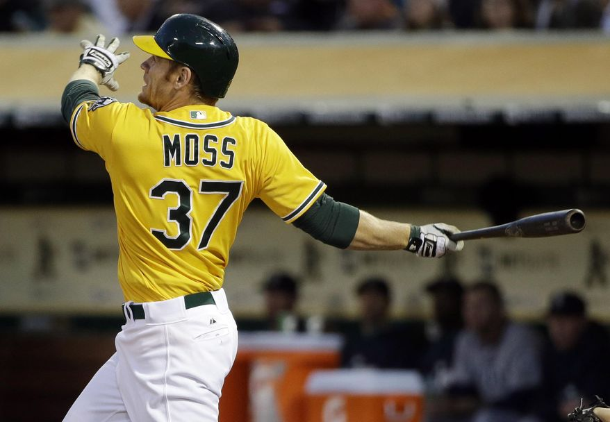 Oakland Athletics' Brandon Moss hits a two-run home run against the Seattle Mariners during the fourth inning of a baseball game on Monday, May 5, 2014, in Oakland, Calif. (AP Photo/Marcio Jose Sanchez)