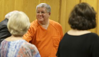 Bernie Tiede smiles after a court hearing granting his release at the Panola County court house in Carthage, Texas, Tuesday, May 6, 2014.  The former mortician whose killing of a rich widow shook an East Texas town and later inspired a movie will soon go free, after the district attorney who prosecuted him agreed Tuesday to let him out of a life sentence. (AP Photo/LM Otero)