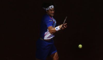 David Ferrer from Spain returns the ball during a Madrid Open tennis tournament match against Albert Ramos from Spain, in Madrid, Spain, Tuesday, May 6, 2014. (AP Photo/Andres Kudacki)