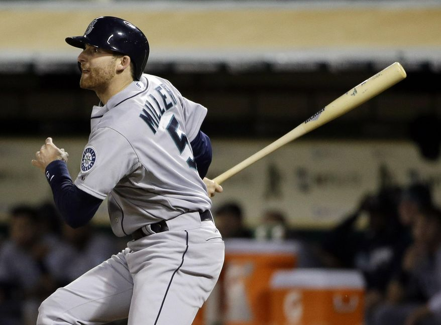 Seattle Mariners' Brad Miller drives in a run with a single against the Oakland Athletics during the sixth inning of a baseball game on Monday, May 5, 2014, in Oakland, Calif. (AP Photo/Marcio Jose Sanchez)