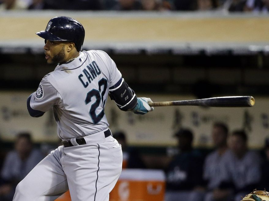 Seattle Mariners' Robinson Cano single against the Oakland Athletics during the fifth inning of a baseball game on Monday, May 5, 2014, in Oakland, Calif. (AP Photo/Marcio Jose Sanchez)