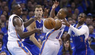 Oklahoma City Thunder forward Serge Ibaka (9) and guard Russell Westbrook (0) watch a loose ball along with Los Angeles Clippers forward Blake Griffin (32) and guard Chris Paul (3) in the second quarter of Game 1 of the Western Conference semifinal NBA basketball playoff series in Oklahoma City, Monday, May 5, 2014. Los Angeles won 122-105. (AP Photo/Sue Ogrocki)
