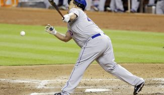 New York Mets' Bartolo Colon fouls the ball as he hits during the sixth inning of a baseball game against the Miami Marlins, Tuesday, May 6, 2014, in Miami. The Marlins won 3-0. (AP Photo/Wilfredo Lee)