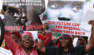 "Women attend a demonstration calling on the government to rescue kidnapped school girls of a government secondary school Chibok, in Lagos, Nigeria, Monday May 5, 2014. Their plight — and the failure of the Nigerian military to find them — has drawn international attention to an escalating Islamic extremist insurrection that has killed more than 1,500 so far this year. Boko Haram, the name means ""Western education is sinful,"" has claimed responsibility for the mass kidnapping and threatened to sell the girls. The claim was made in a video seen Monday. The British and U.S. governments have expressed concern over the fate of the missing students, and protests have erupted in major Nigerian cities and in New York. (AP Photo/Sunday Alamba)"