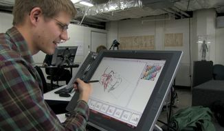 """This photo provided by 2K Games shows a student drawing an illustration in the film, """"The Art of the Game.""""  2K Games commissioned filmmaker Matthew Davis Walker and his production company Story Developing to create the feature-length documentary, set to debut for free Thursday, May 8, 2014, on Machinima's Twitch.tv channel and later on Xbox Live and YouTube. The film chronicles budding game designers at the Academy of Art University in San Francisco who competed last year for an internship at 2K by creating short computer-generated films set in the fictional realm from the """"Borderlands"""" games. (AP Photo/2K Games)"""